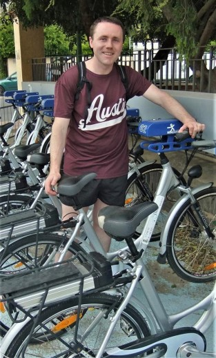 David Curran, site author, standing in a row of bicycles